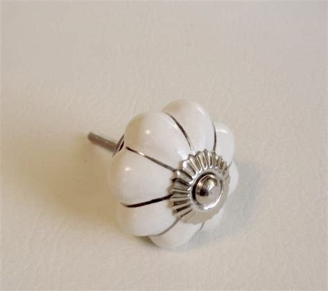 white cabinet knobs soft white porcelain cabinet knobs pulls silver accents 1