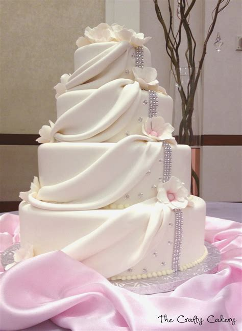 draping fondant draped fondant wedding cake with white flowers and
