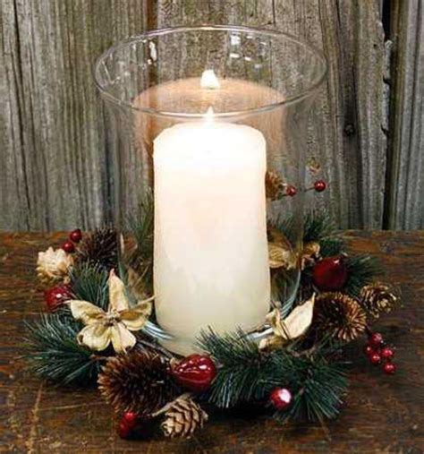 hurricane glass candle holder with decorated wreath