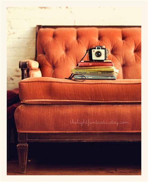 vintage orange velvet sofa reading nook print vintage books