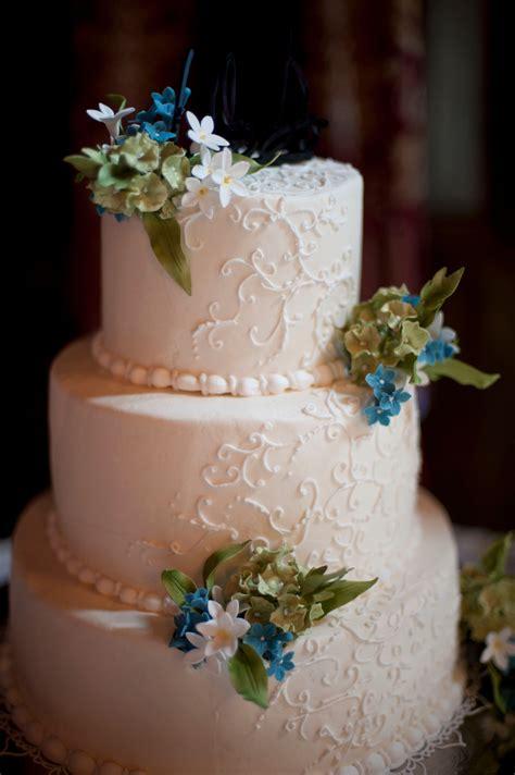 ivory wedding cake  green blue  white flowers