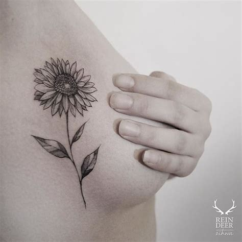 small side boob tattoos placement fancy sunflower side n
