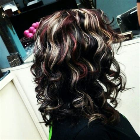 this beautiful hair color was created by foiling the top beautiful hair dark brown base with bright blonde and red