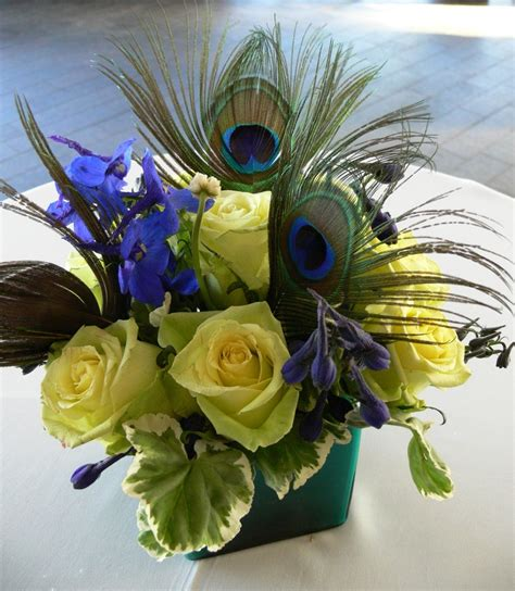silk flower arrangement peacock feathers in home decor and peacock feathers add a unique touch to this cocktail