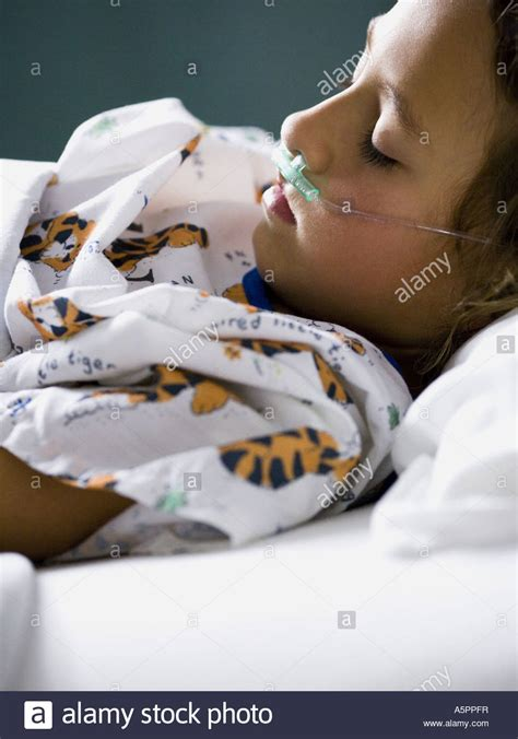 girl in hospital bed young girl in hospital bed with respirator stock photo