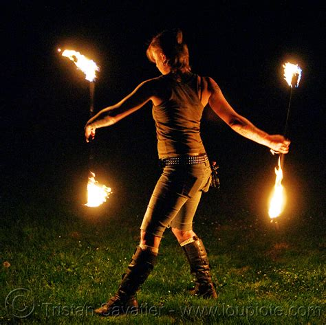 spinning fire staves on the grass leah