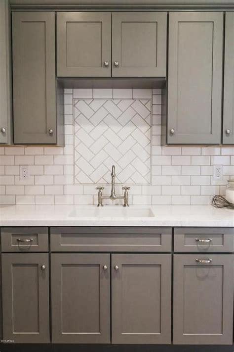 gray distressed kitchen cabinets with marble herringbone 12 subway tile backsplash design ideas installation tips