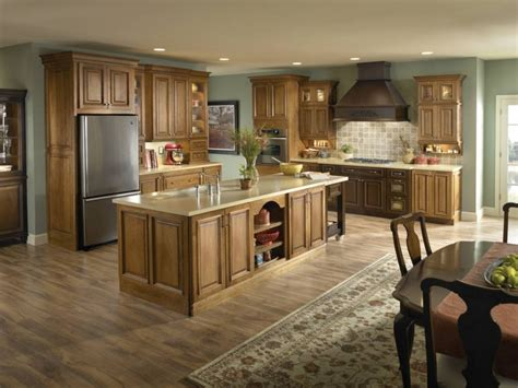 green tosca kitchen paint color with brown varnished oak wood cabinets of fantastic kitchen