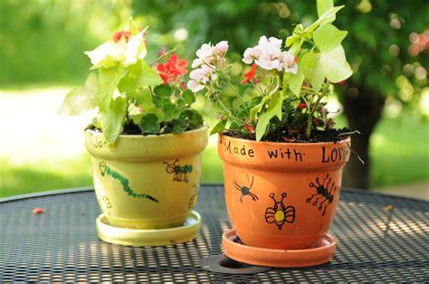 Fingerprint Flower Pots Kids Can Make As A Garden Gift Flowers For Garden Pots