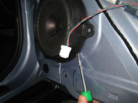 nissan versa front door panel removal speaker replacement guide 029 nissan versa front door panel removal speaker replacement guide 019