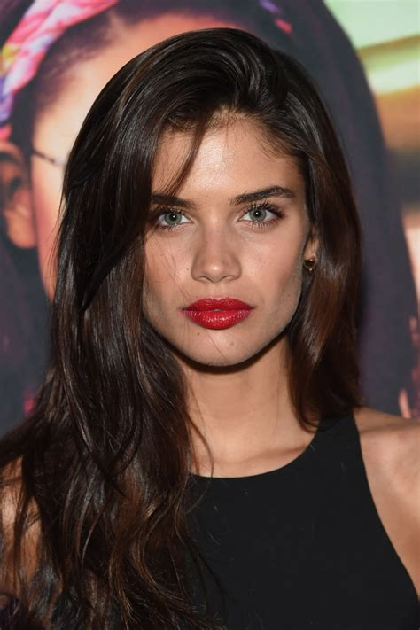 a side part with long hair and a swoop and a cross sara saio long side part long side part lookbook