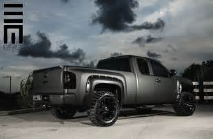 matte black silverado with offroad wheels fender flares