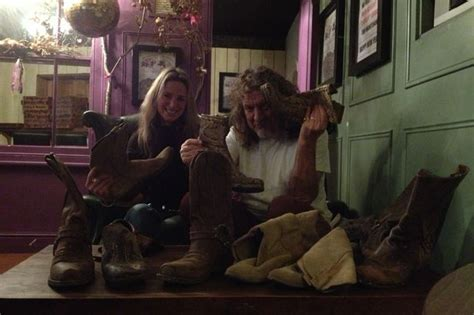 celebrity auction house robert plant with lynn allbutt for celebrity shoe charity