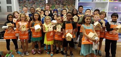 home depot reps help hawthorne students make birdhouses