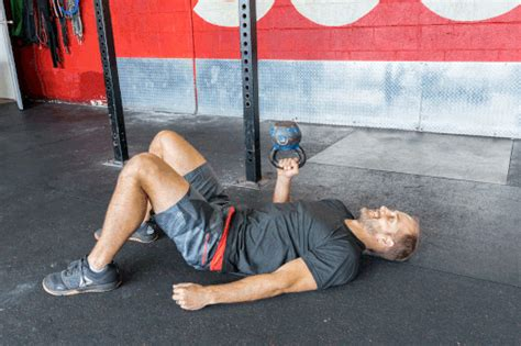 bench press gif the 12 best kettlebell exercises you re not doing