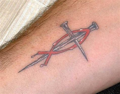 christian symbol tattoos jesus fish with cross on arm busbones