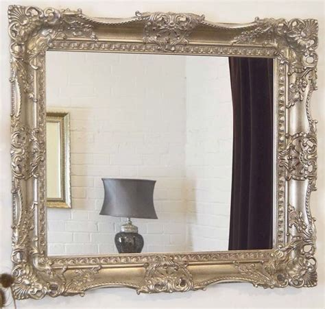 silver decorative ornate carved wall mirror