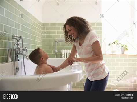 mom bathroom mother son having fun bath time image photo bigstock