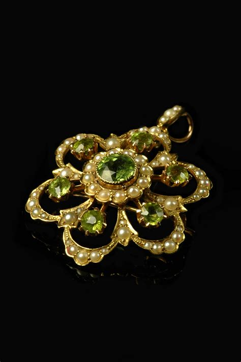 victorian 15ct yellow gold peridot and pearl flower