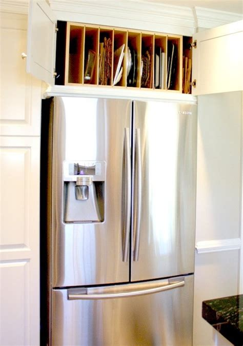 above refrigerator storage ideas for using that awkward space above the fridge