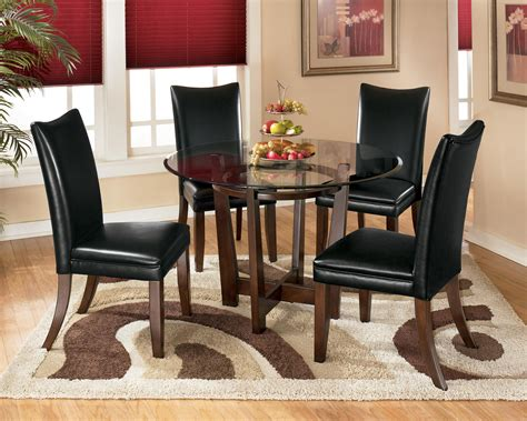 small brown table with black chairs for grey dining room