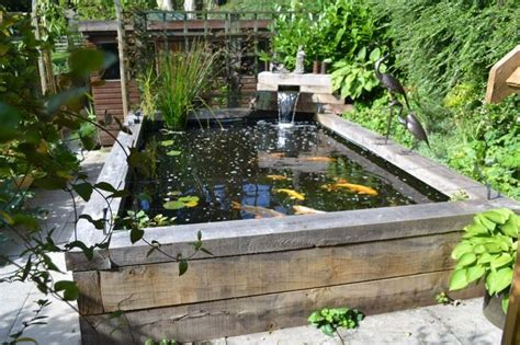 backyard bassin koi carp pond with railway sleepers water features