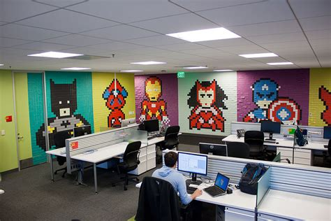 creative agency staff installs superhero murals
