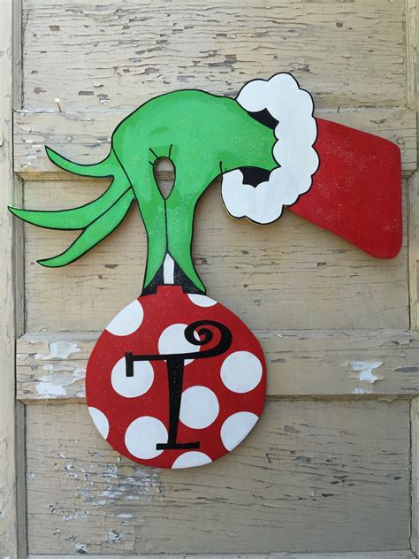 printable grinch ornaments grinch hand and ornament door hanger by kenlyscreations on