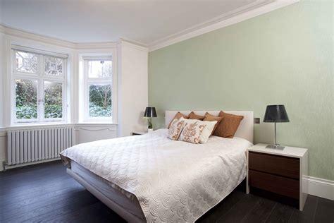 master bedroom dark hardwood floor light green wall