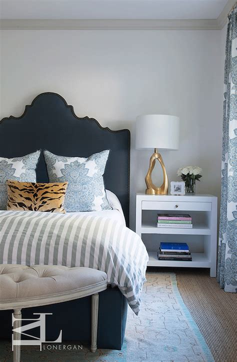 Dark blue arched headboard with nailhead trim transitional bedroom
