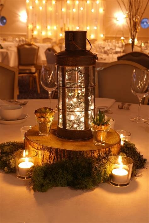 woodland wedding themed table centres wooden slice table