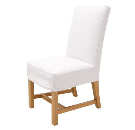 quatrine exposed leg dining chair slipcovered in white