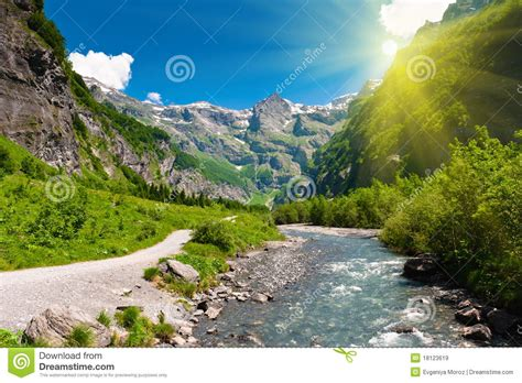Alpine Sun L by Idyllic Alpine Valley In Sun Rays Royalty Free Stock