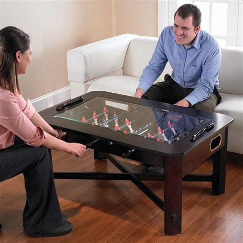 what to put on a coffee table foosball coffee table set your drink put your feet up