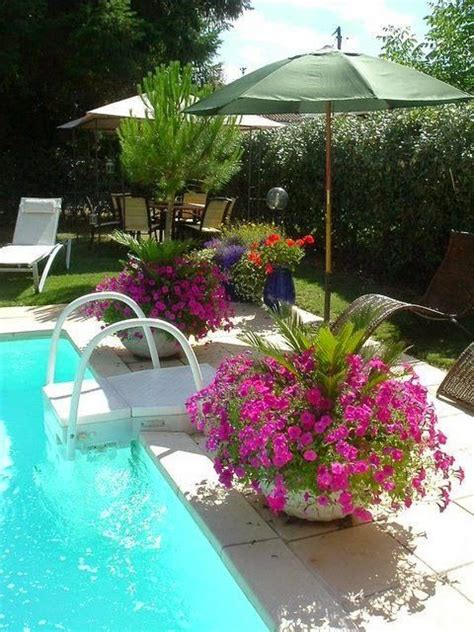 where to put a pool in your backyard pool landscaping great idea to put umbrellas in pots
