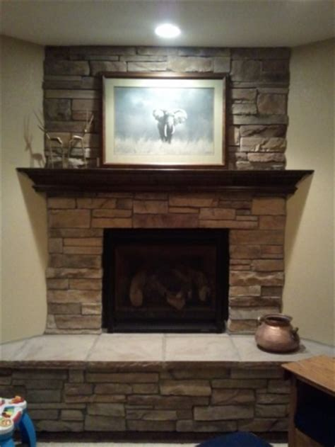 stone fireplace with mantle craftsman basement finish