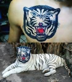 tattoo real animal terrible tattoos of bad portraits and animal drawings are