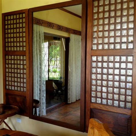house windows design in the philippines simple low cost mirror flanked by reclaimed capiz windows