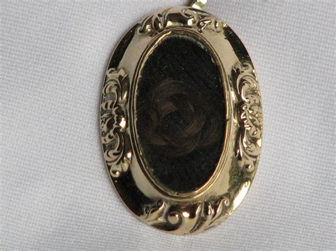 antique mourning pendant with knot of hair from