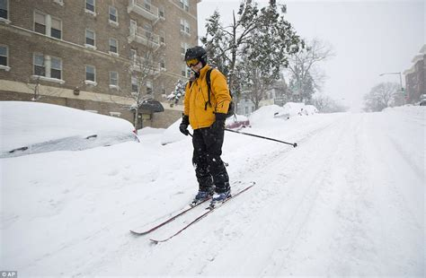 another 10 inches of snow at breck jonas leaves ten dead as 85million are told stay