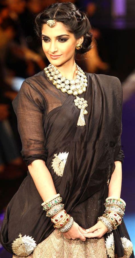 sonam kapoor hairstyles in saree sonam kapoor black and gold lehenga indian jewelry desi