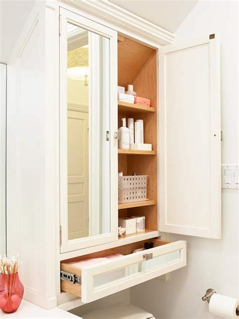 bathroom storage idea mirrored doors transitional bathroom bhg