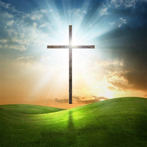 christian cross  grassy background mchatton sadler funeral chapels