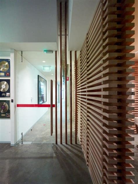 Slat wall / stacked wood   For the Home   Pinterest