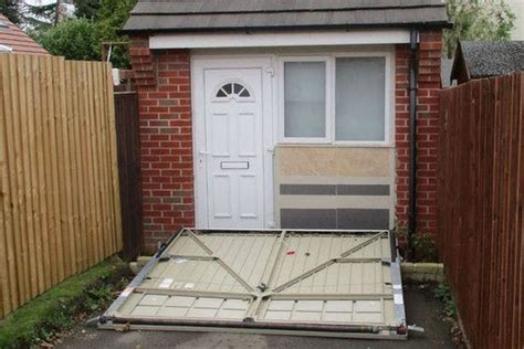 garage door tiny house u k couple used a fake garage door to hide illegal tiny