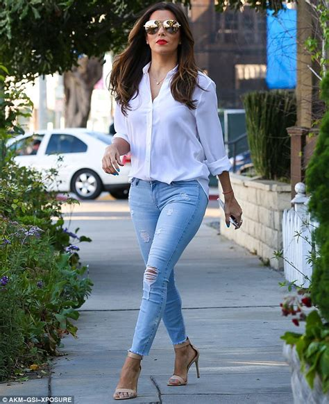 eva longoria looks expectant in blouse as she attends political eva longoria looks fantastic in tight jeans and a white