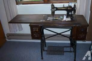 antique white rotary treadle sewing machine and cabinet