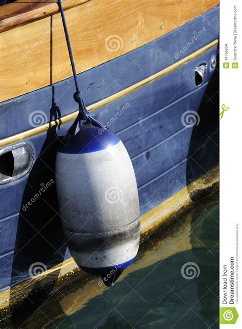 side of a fishing boat buoy on side of boat stock images image 14766204