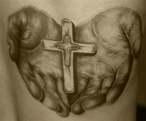 hand holding cross tattoo 17 best images about tattoos on cardinal bird