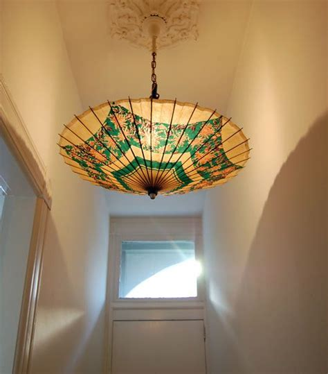 diy light fixtures for the unique and inexpensive light attach a paper umbrella to an existing light fixture to